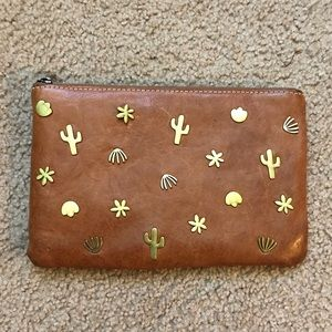 Madewell clutch with metal charms